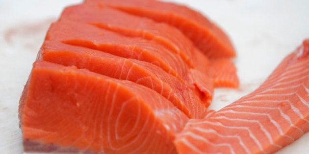 FILE - This Friday, May 18, 2012 file photo shows fliets of Copper River Salmon from Alaska in Seattle. Eating fish is good for your heart but taking fish oil capsules does not help people at high risk of heart problems who are already taking medicines to prevent them, a large study in Italy found. The work, published in the Thursday, May 9, 2013 New England Journal of Medicine, makes clearer who does and does not benefit from taking supplements of omega-3 fatty acids, the good oils found in fish such as salmon, tuna and sardines. (AP Photo/Ted S. Warren)
