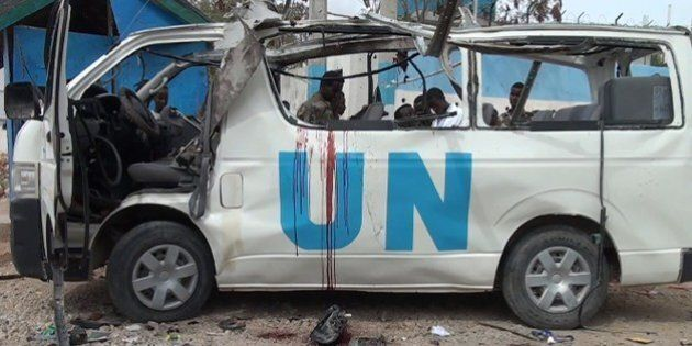 GRAPHIC CONTENTBlood is seen in the shell of a UN van following a bomb attack that killed at least six UN workers on April 20, 2015 in the northeastern town of Garowe. Somalia's Al-Qaeda-affiliated Shebab insurgents claimed responsibility for the attack, in which they exploded a huge bomb in a staff bus, branding the United Nations a 'colonisation force in Somalia'. AFP PHOTO/STRINGER        (Photo credit should read STRINGER/AFP/Getty Images)