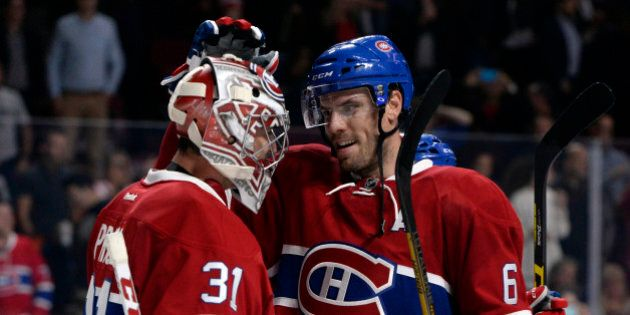 Oct 6, 2016; Montreal, Quebec, CAN; Montreal Canadiens goalie Carey Price (31) and teammate Shea Weber (6) react after defeating the Toronto Maple Leafs during a preseason hockey game at the Bell Centre. Mandatory Credit: Eric Bolte-USA TODAY Sports