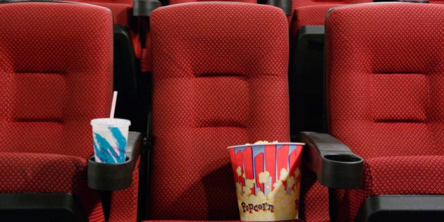 Popcorn and Soft Drink in Empty Seat at the Movie