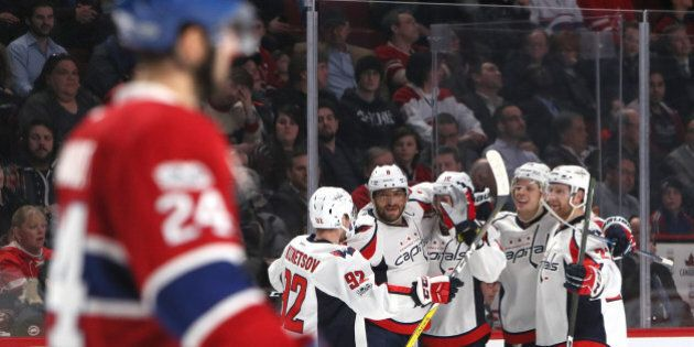 Jan 9, 2017; Montreal, Quebec, CAN; Washington Capitals right wing Brett Connolly (10) celebrates his goal against Montreal Canadiens with teammates during the third period at Bell Centre. Mandatory Credit: Jean-Yves Ahern-USA TODAY Sports