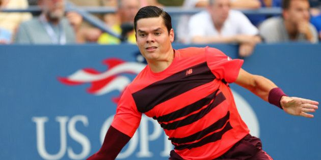 NEW YORK, NY - SEPTEMBER 04: Milos Raonic of Canada returns a shot against Feliciano Lopez of Spain during...
