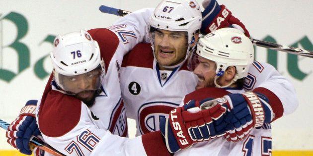 Montreal Canadiens left wing Max Pacioretty,center, is congratulated by defenseman P.K. Subban, left,...
