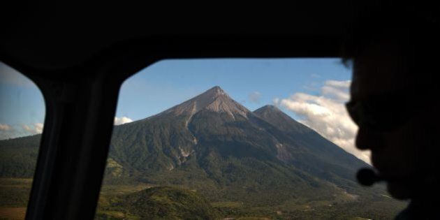 A picture taken through a helicopter window shows an aerial view of the Fuego (L) and the Acatenango...