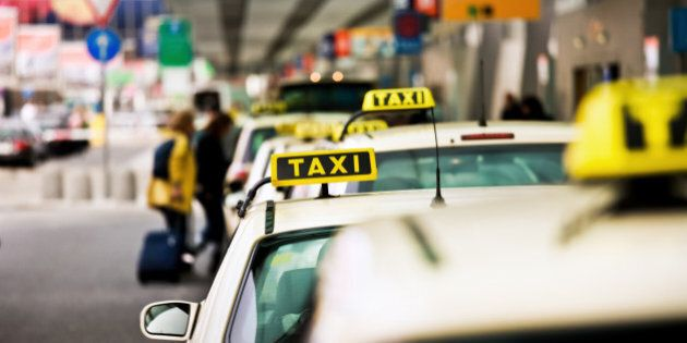 German Taxis at an airport in a row.