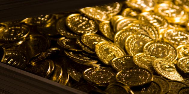 Gold coins in a metal