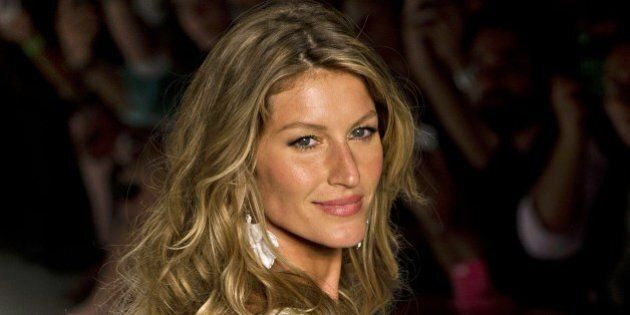 Brazilian supermodel Gisele Bundchen presents a creation by Colcci during the 2015 Summer collections...