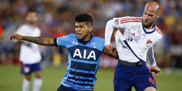 Tottenham Hotspur defender DeAndre Yedlin, left, battles for position with MLS All-Star defender Laurent...