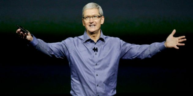 Apple CEO Tim Cook wraps up the latest Apple event at the Bill Graham Civic Auditorium in San Francisco,...