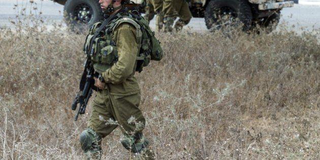 Israeli soldiers patrol an army deployment area near the Israeli-Gaza border,on July 19, 2014. Israeli...