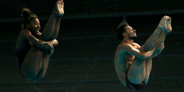 Jennifer Abel and Francois Imbeau-Dulac of Canada dive during the mixed 3m springboard synchronised final...