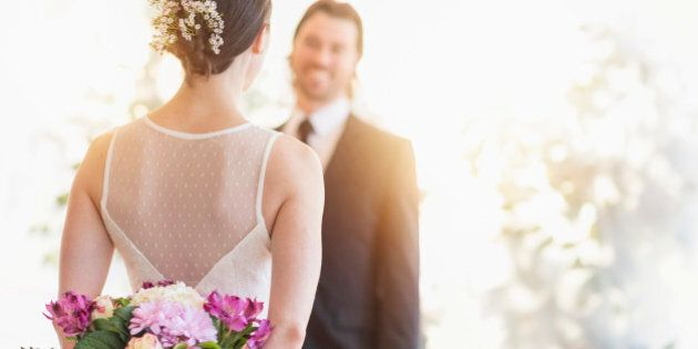 USA, New Jersey, Bride and groom looking at each