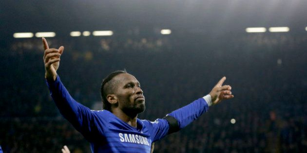 Chelsea's Didier Drogba celebrates scoring his side's second goal during the English Premier League soccer...