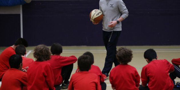 LONDON, ENGLAND - DECEMBER 01:  Boys take part in a basketball lesson in the sports hall at a secondary school on December 1, 2014 in London, England. Education funding is expected to be an issue in the general election in 2015.  (Photo by Peter Macdiarmid/Getty Images)