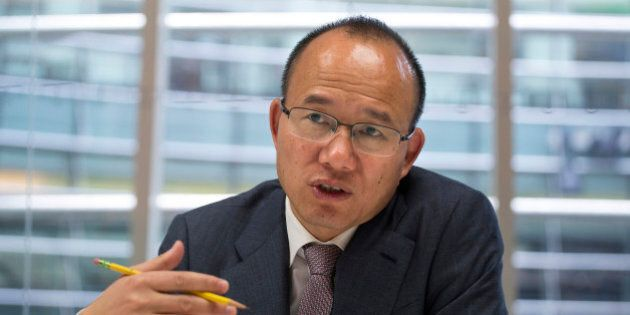 Billionaire Guo Guangchang, chairman and chief executive officer of Fosun Group, speaks during an interview...