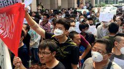 Décontamination et manifestations après l'explosion de Tianjin