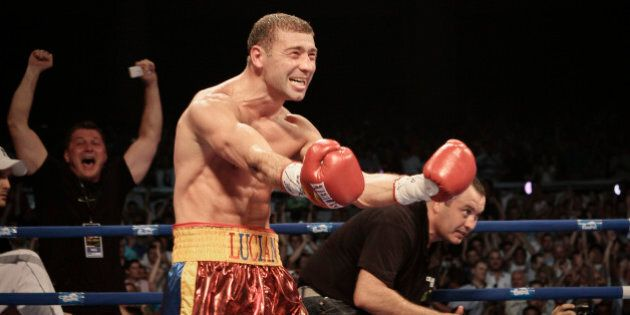 IBF Super Middleweight champion Lucian Bute reacts after knocking out Jean-Paul Mendy of France in Bucharest,...
