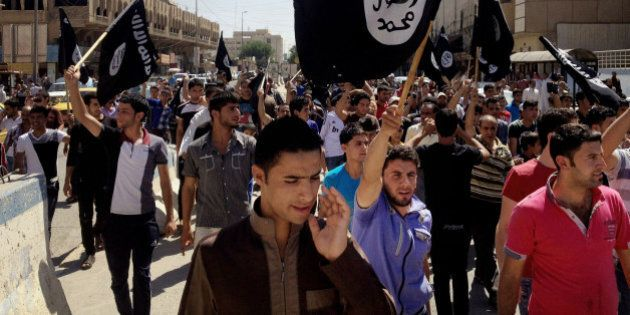 FILE - In this Monday, June 16, 2014 file photo, demonstrators chant pro-Islamic State group slogans...