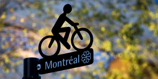 The Montreal logo is displayed on a bike lane sign in Montreal, Quebec, Canada, on Saturday, Nov. 5,...