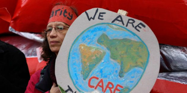 A climate activist demonstrates in Paris, Saturday, Dec.12, 2015 during the COP21, the United Nations...