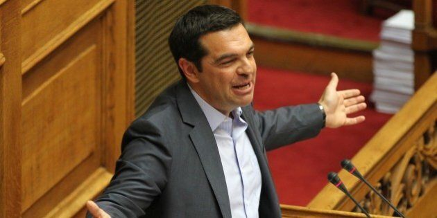 ATHENS, GREECE - AUGUST 14 : Greek Prime Minister Alexis Tsipras addresses the parliament during a vote...