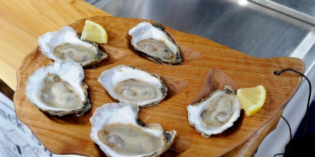 PORTLAND, ME - JULY 31: Brendan Parsons, owner of BP's Shuck Shack, prepared a half dozen oysters in...