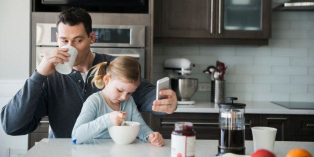 Father and daughter in kitchen in the morning