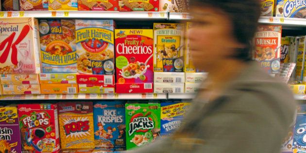 UNITED STATES - SEPTEMBER 21: A shopper pushes her cart down the cereal aisle, including General Mills...
