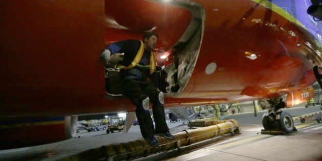 In this Nov. 13, 2014 photo, Southwest Airlines ground crewman Dillard Blue prepares to jump out of the...