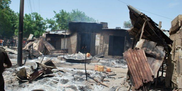 A photo taken on July 4, 2015 shows houses burnt by Boko Haram fighters at Zabarmari, a fishing and farming...