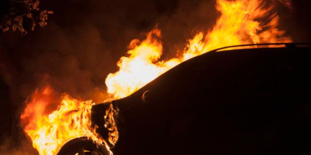 Fire in an automobile engine compartment, and tire burning.