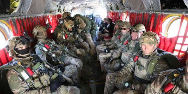 PETAWAWA, ON - JUNE, 1 A chinook helicopter is loaded with Special Forces for a training parachute jump.At...