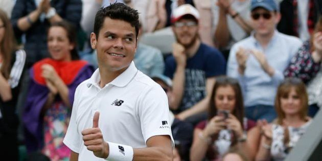 Canada's Milos Raonic celebrates beating Italy's Andreas Seppi during their men's singles second round...