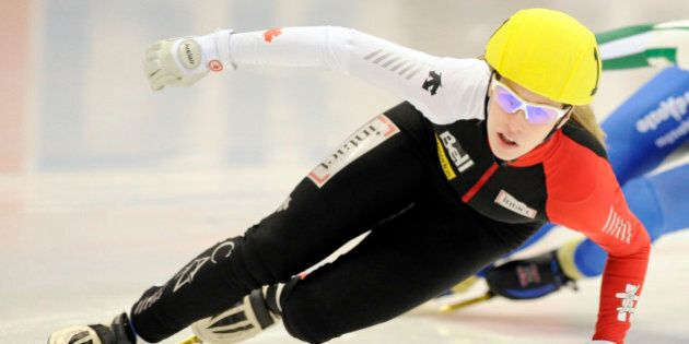 Winner Marianne St-Gelais of Canada competes during the 500 meter women's final race at the Short Track Speed Skating World Cup in Dresden, Sunday, Feb. 20, 2011. (AP Photo/Jens Meyer)