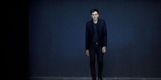 French designer Hedi Slimane appears at the end of  his Spring/Summer 2013 women's ready-to-wear fashion show for French fashion house Saint Laurent Paris during Paris fashion week October 1, 2012.     REUTERS/Gonzalo Fuentes (FRANCE  - Tags: FASHION)