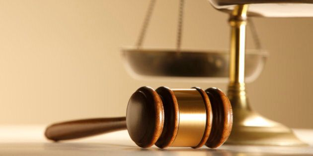 A gavel in front of a justice