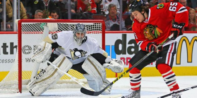 Jan 6, 2016; Chicago, IL, USA; Chicago Blackhawks center Andrew Shaw (65) with the puck in front of Pittsburgh Penguins goalie Marc-Andre Fleury (29) during the first period at the United Center. Mandatory Credit: Dennis Wierzbicki-USA TODAY Sports