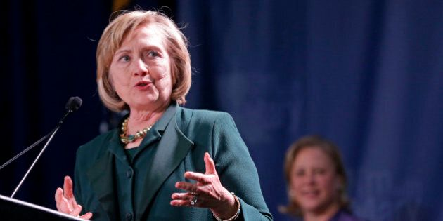 Former Secretary of State Hillary Clinton speaks at a campaign event for Sen. Mary Landrieu, D-La., background,...