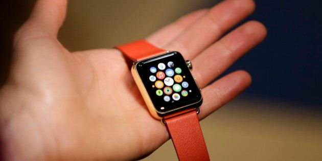 A woman holds the Apple Watch Edition during a demo following an Apple event Monday, March 9, 2015, in...