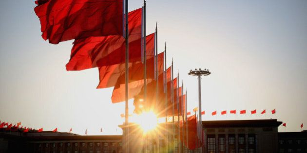 BEIJING, CHINA - MARCH 09: The red flags flutter in the wind outside the Great Hall of the People during...