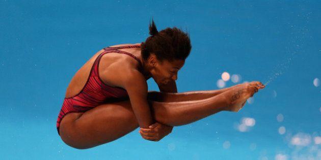 DUBAI, UNITED ARAB EMIRATES - MARCH 21: Jennifer Abel of Canada dives in the Women's 3m Springboard semi...