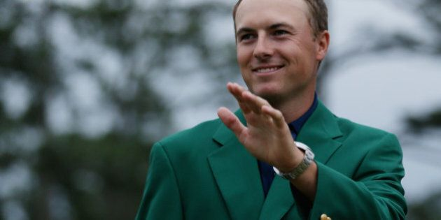 AUGUSTA, GA - APRIL 12: Jordan Spieth of the United States poses with the green jacket after winning...