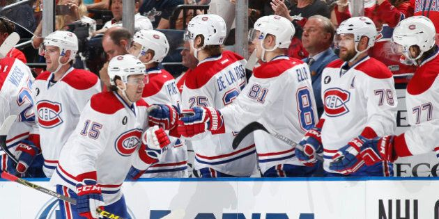 SUNRISE, FL - APRIL 5: P.A. Parenteau #15 of the Montreal Canadiens is congratulated by teammates after...