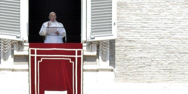 Pope Francis addresses the crowd from the window of the apostolic palace overlooking St.Peter's square...