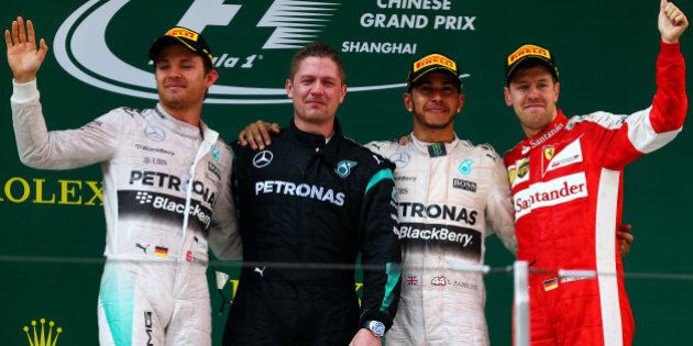 SHANGHAI, CHINA - APRIL 12: Second placed Nico Rosberg (L) of Germany and Mercedes GP, first placed Lewis...