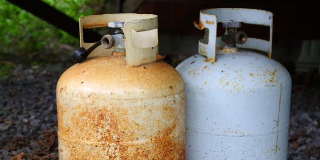 Two old rusty dangerous gas/propane
