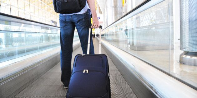 traveler with a suitcase on the