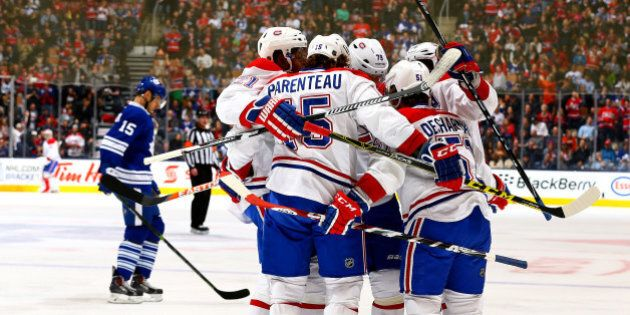 TORONTO, ON - APRIL 11:  The Montreal Canadiens celebrate David Desharnais goal against the Toronto Maple Leafs during NHL action at the Air Canada Centre April 11, 2015 in Toronto, Ontario, Canada.  (Photo by Abelimages/Getty Images)