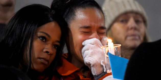 A woman cries during a candlelight vigil for shooting victims on Thursday, Dec. 3, 2015, at San Manuel...