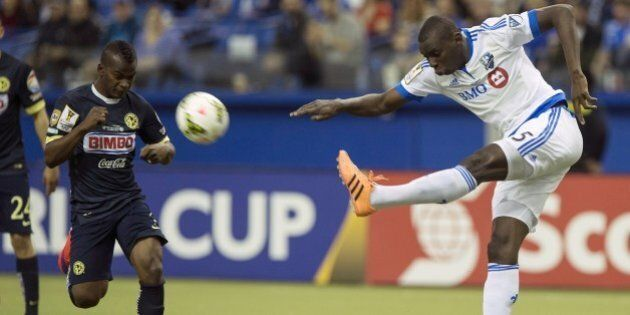 Bakary Soumare (R) of the Montreal Impact clears the ball in front of Club America's Darwin Quintero...